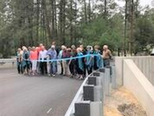 ribbon cutting at bridge