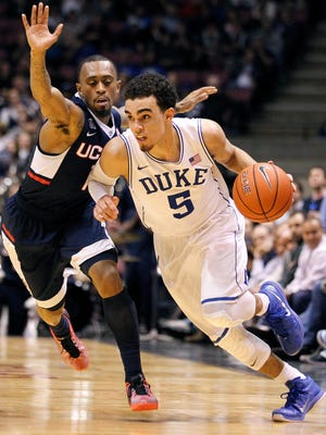 Tyus Jones drives against Connecticut guard Ryan Boatright during the second half.