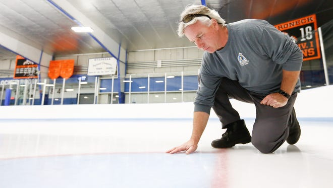 Rob Lunde, general manager, inspects the ice at Hommocks Park Ice Rink.