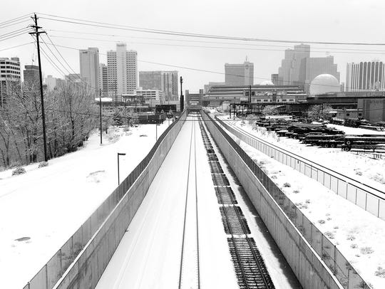 Fresh snow is seen in Reno from the Wells Avenue overpass