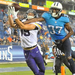 Aug 28, 2014; Nashville, TN, USA; Minnesota Vikings wide receiver Adam Thielen (19) catches a touchdown pass against Tennessee Titans defensive back Tommie Campbell (37) during the first half at LP Field. Mandatory Credit: Jim Brown-USA TODAY Sports