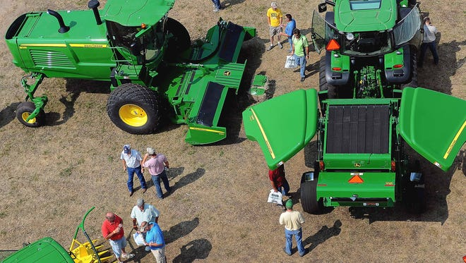 In this Aug. 19, 2014 photo, attendees to Dakotafest view the different farm machinery during the 3-day agricultural industry trade show in Mitchell, S.D.