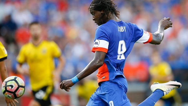 FC Cincinnati Djiby Fall (9) kicks on goal in the first half of the US Open Cup soccer match between FC Cincinnati and Columbus Crew at Nippert Stadium in Cincinnati on Wednesday, June 14, 2017. At the end of the first half the game was tied at 0.