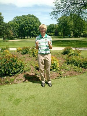 Green Bay Preble junior Isaac Prefontaine holds up one of his winning scorecards from last month.