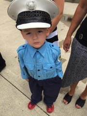Max, 4, was in line with his mother Tonya Wallace-Mullins to pay respects to fallen officer Sonny Kim.