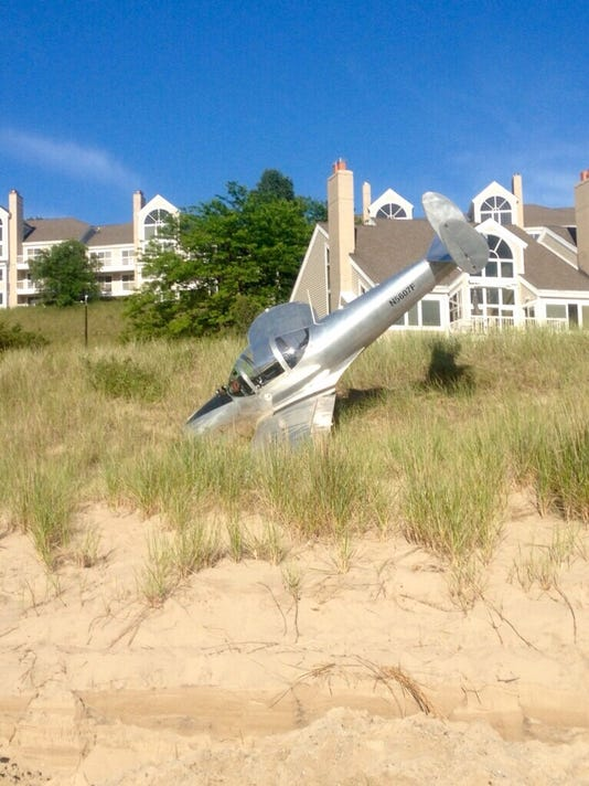 635729331087457647-plane-on-holland-beach-via-Jake-Tufts