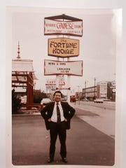 Mike Wong, owner or Oriental Wok, in front of one of the restaurants where he worked in the 1970's, the Fortune Kookie in Roselawn