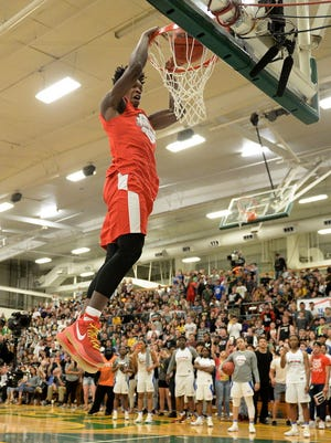 American Family Insurance Slam Dunk athlete Lonnie Walker competes in the American Family Insurance slam dunk and three-point championships at Greenway High School.