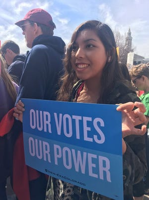 Bella Yow, a senior at St. John's High School, joined thousands of other protesters at the March for Our Lives rally in Denver.