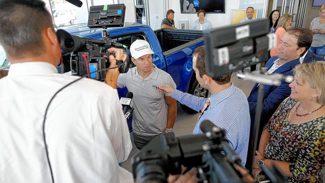 Actor/singer Mark Wahlberg answers questions from the media during an Aug. 13 visit to Mark Wahlberg Chevrolet, the car dealership he bought recently on the west side.