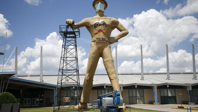 A surgical mask sits painted on the Golden Driller at Expo Square in Tulsa on Wednesday, July 8, 2020.