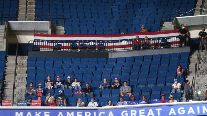 Attendees watch a campaign rally for President Donald Trump on Saturday night at the BOK Center in Tulsa, Okla. [The Associated Press