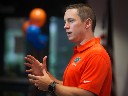 University of Florida men's basketball coach Mike White visits the Southwest Florida Gator Club on Monday at Six Bends Harley-Davidson in Fort Myers.