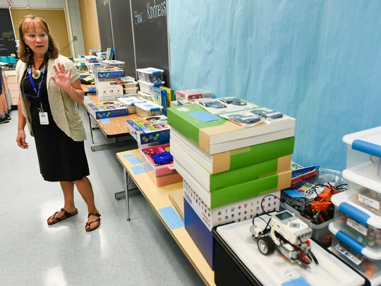Jenny McNew, media specialist, show the STEM project boxes for different grades Thursday, Sept. 14, at Talahi Community School.
