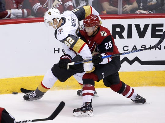 Vegas Golden Knights left wing Tomas Nosek (92) battles Arizona Coyotes center Nick Cousins (25) for the puck during the NHL home opener at Gila River Arena in Glendale on October 7, 2017.