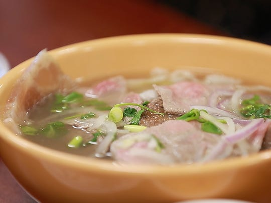 Pho is originally a Vietnamese rice noodle soup served with hot broth along with different selection of meats. It includes meat balls, beef tripe, tendon, beef flank, bean sprouts, basil, green onion and cilantro.
