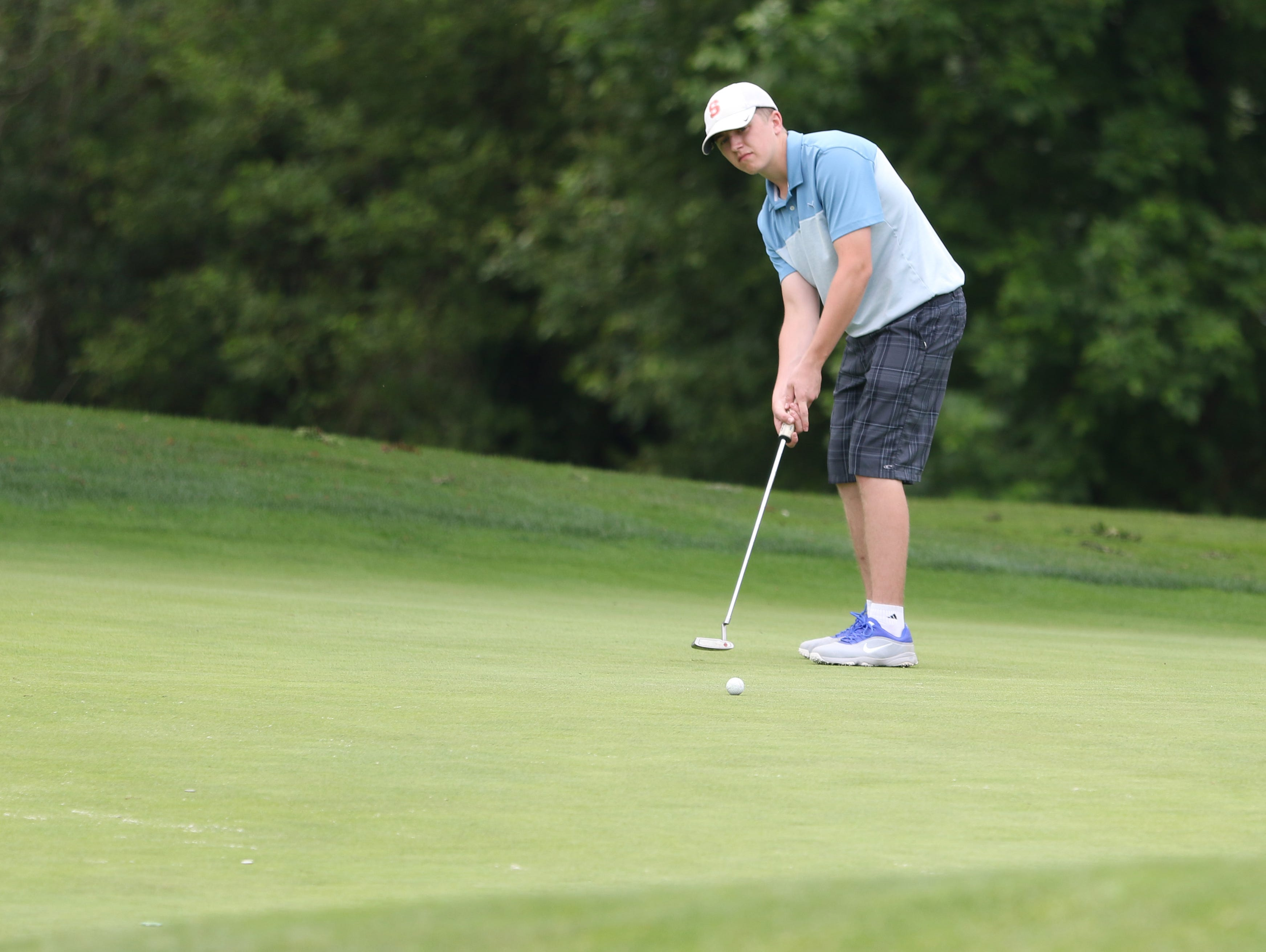 South Salem's Trevor Lawrence putts during the final day of the Greater Valley Conference District Golf Tournament on Tuesday, May 3, 2016, at Trysting Tree Golf Club in Corvallis, Ore.