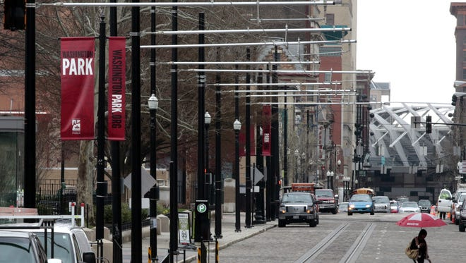 Support poles for streetcar wires line Elm Street in near Music Hall.