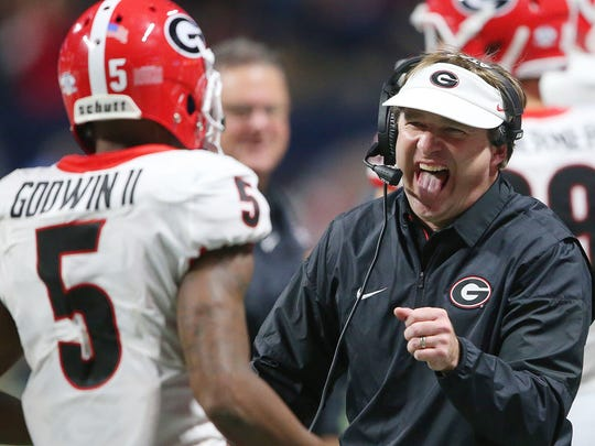 Georgia head coach Kirby Smart reacts after Georgia wide receiver Terry Godwin (5) scored a touchdown against Auburn during the second half of the Southeastern Conference championship NCAA college football game, Saturday, Dec. 2, 2017, in Atlanta.