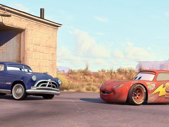 Doc Hudson (left, voiced by Paul Newman) is initially