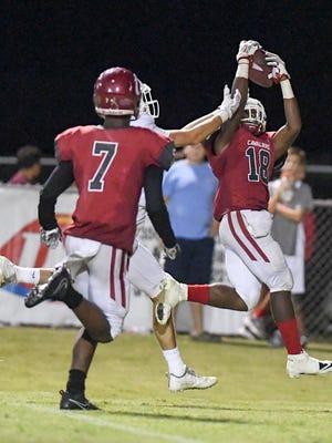 Crockett County's Dennis Buchanan intercepts a ball thrown to a University School of Jackson receiver during their game, Friday, Aug. 25.