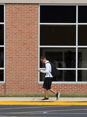A student leaves school wearing a white shirt at Caesar Rodney High School in Camden.