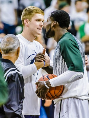 Russell Byrd, left, is greeted by former MSU teammate Branden Dawson prior to an exhibition game between The Master's College and MSU on Nov. 3. Byrd transferred to Master's after last season, but still feels a connection to his old teammates as they make their Final Four run.