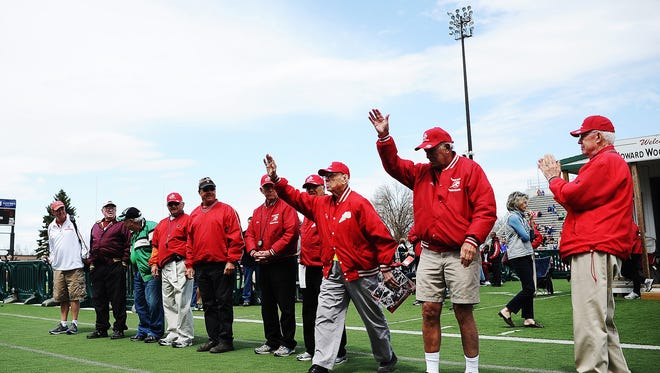 Longtime meet official Rich Hanson (far right) applauds past winners of the honorary referee award at the Howard Wood Dakota Relays on Saturday.
