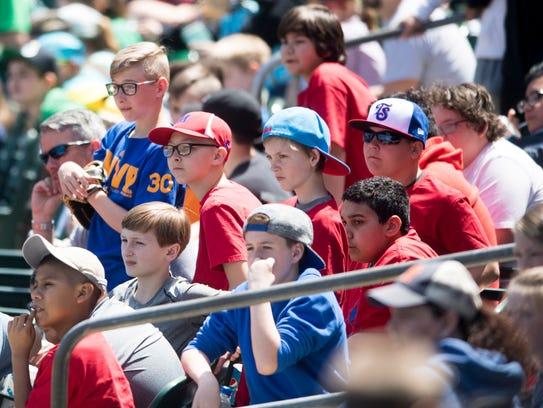 School children watch the game between the Tennessee