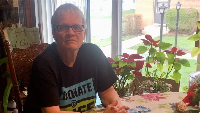 Beverly Hindman sits in the kitchen of her Marion home. She has dedicated the past seven years of her life to raising awareness about organ donation.