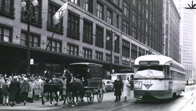 One of Detroit's old streetcars passes by Hudson's Department Store downtown.
