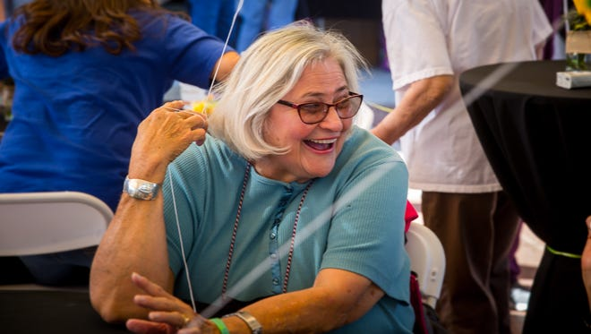 Carla Balizan has a laugh while talking about the life of her late friend Norma Provencio during MountainView Regional Medical Center's celebration of those treated at the center who's passing allowed tissue to be donated to patients. Over 200 family and friends of those whose death allowed subsequent tissue donation were at the celebration, April 14, 2016.