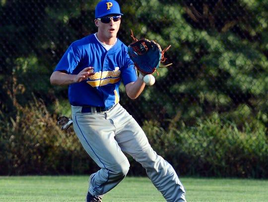 Pleasureville center fielder Ryan Crum grabs a bouncing