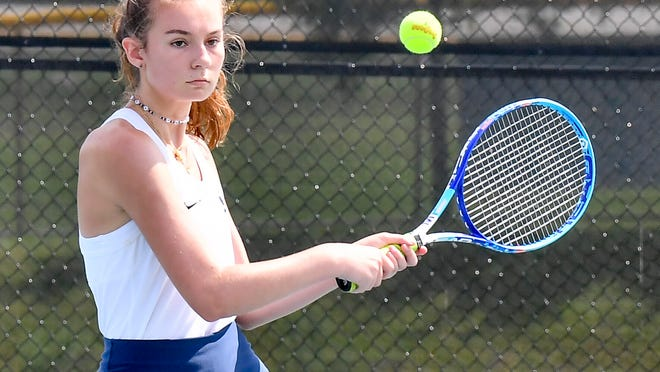 Katie Tuttle gets ready to hit a backhand during host Hudson's 4-1 victory over Hathaway Brown's B team Tuesday.