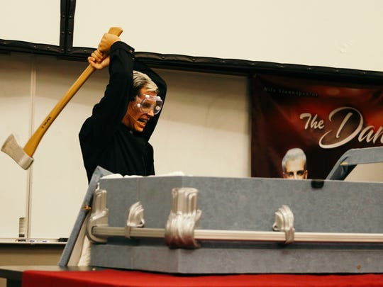 Yiannopoulus destroys the coffin during his funeral for Twitter.