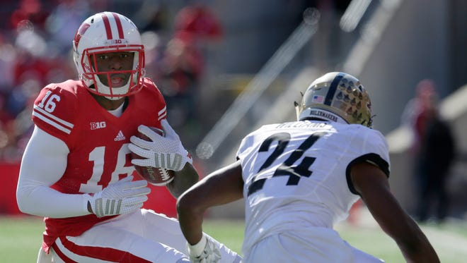 Wisconsin wide receiver Reggie Love (16) looks to pick up extra yardage on a reception during the second quarter of their game against Purdue on October 17, 2015.