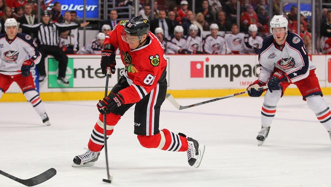 Chicago Blackhawks right wing Marian Hossa (81) shoots with Columbus Blue Jackets center Ryan Johansen (19) in pursuit during the third period at the United Center.