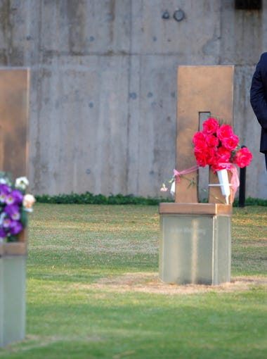 Former President Bill Clinton stands in the Field of Empty Chairs at the chair of Oklahoma City bombing victim Alan G. Whicher,of the U.S. Secret Service, after lying a bouquet of flowers on the chair during a visit to the Oklahoma City National Memorial in Oklahoma City, Wednesday, April 21, 2010. Clinton is in town to accept the sixth annual Reflections of Hope Award for his work in helping Oklahoma City transform following the bombing of the Alfred P. Murrah Federal Building 15 years ago and for his international peace work during his presidency and over the past decade.  (AP Photo/Bryan Terry, Pool)