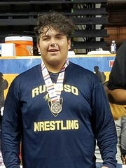 Freshman wrestler Mikey Marin celebrates a second place finish at the state wrestling championships at the Santa Ana Star Center in Rio Rancho.