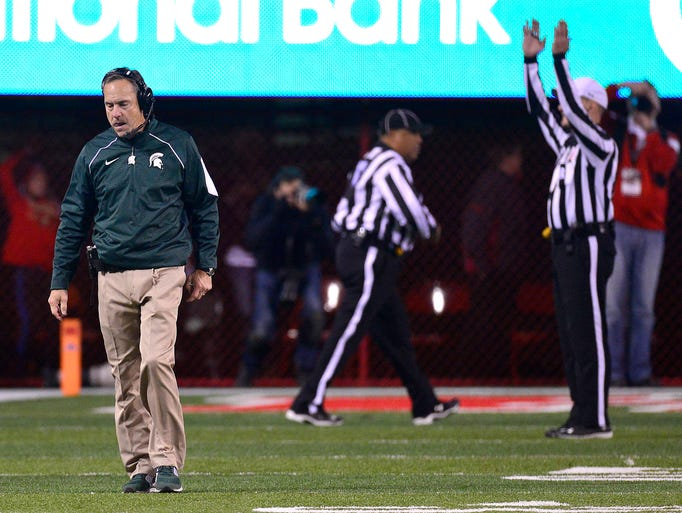 Michigan State coach Mark Dantonio walks away as officials