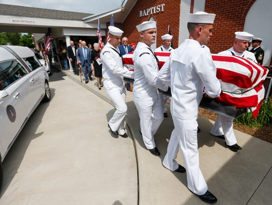 Members of the United States Navy Honor Guard carry