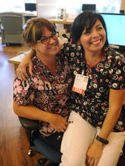 "Nurses Katrina Lomeli, left, and Melissa Garcia have what they described as a debriefing counseling moment at the end of the day at the Sequoia Regional Cancer Center. ""We talk about everything,"" Lomeli said."