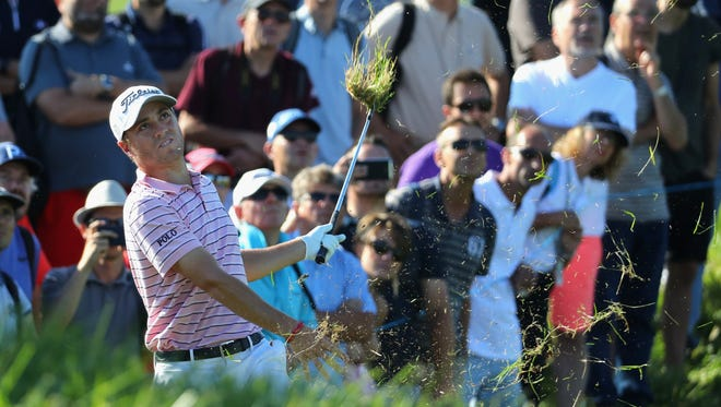 Justin Thomas plays his second shot out the rough on the 14th hole during the first round of the HNA Open de France at Le Golf National on June 28 in Paris.