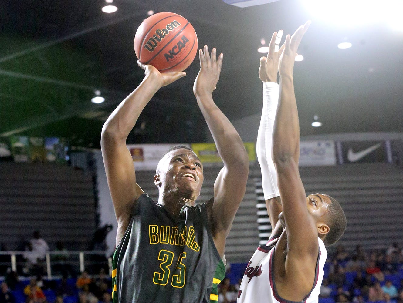 Hillsboro's Thomas Smith (35) goes up for a shot as Memphis East's Teddrick McGhee (5) guards him during the State Tournament Quarterfinal game , on Wednesday at MTSU.