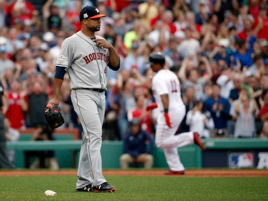 Boston Red Sox's Rafael Devers, right, rounds the bases after his two-run home run off Houston Astros relief pitcher Francisco Liriano, left, during the third inning in Game 3 of baseball's American League Division Series, Sunday, Oct. 8, 2017, in Boston. (AP Photo/Michael Dwyer)