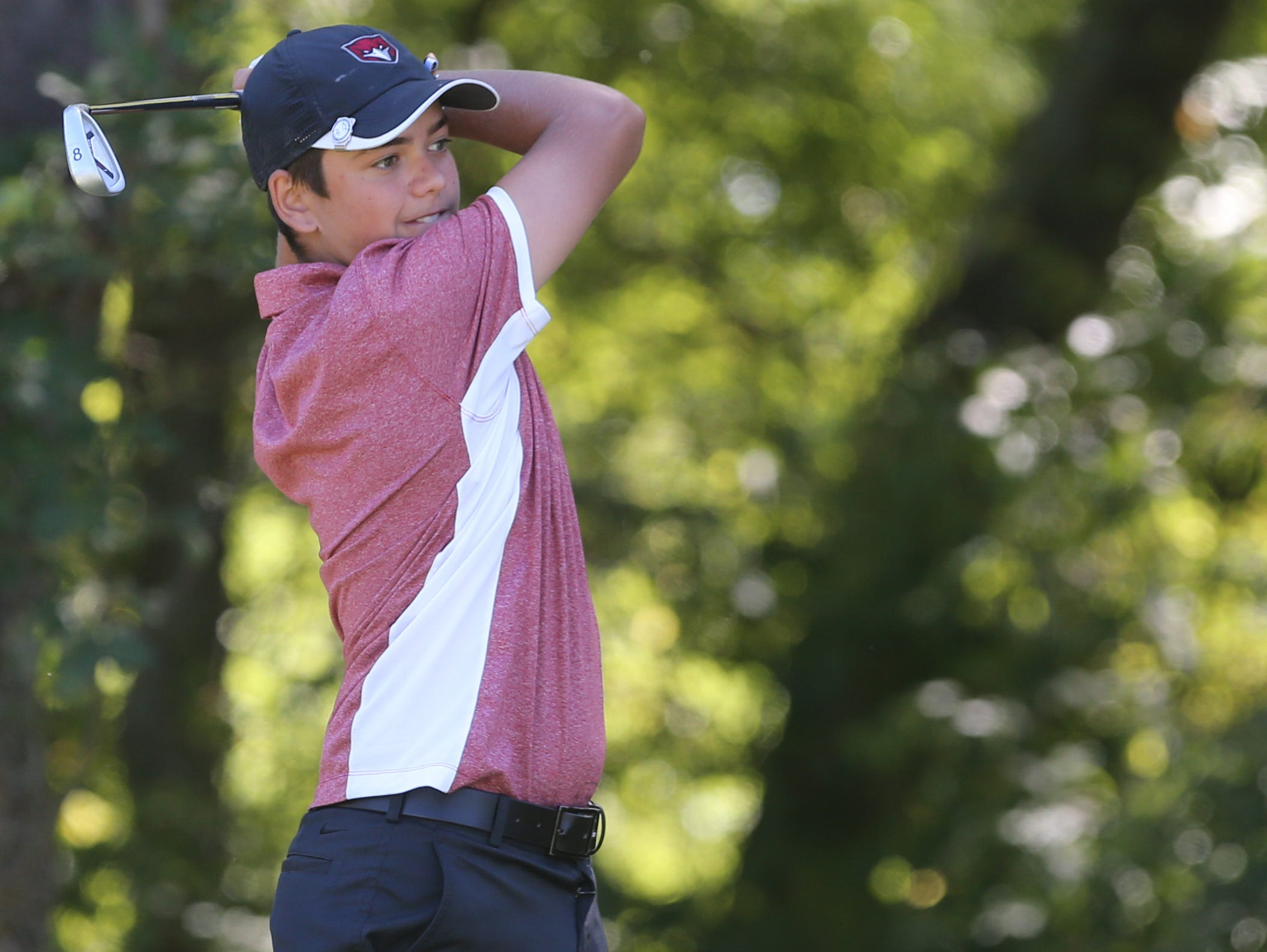 Stewarts Creek's Bryson Hammonds watches his tee shot on No. 17 at Smyrna Municipal Golf Course. Hammonds shot a 77 in Monday's District 7-AAA tournament.