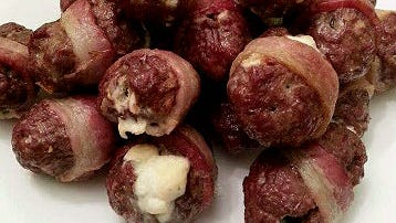 Don't miss: Armadillo Eggs. Fahlsing stuffs feta and cream cheese into fresh jalapenos, wraps them in ground bison and then bacon before baking them. They come out hot and creamy inside, crunchy outside.