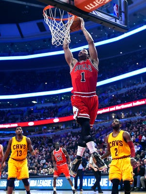 Feb 12, 2015; Chicago, IL, USA; Chicago Bulls guard Derrick Rose (1) dunks the ball against the Cleveland Cavaliers during the first quarter at the United Center. Mandatory Credit: Mike DiNovo-USA TODAY Sports