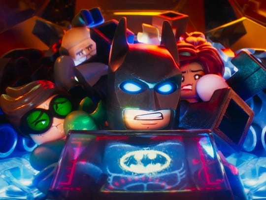 Batman (center, voiced by Will Arnett) has to overcome