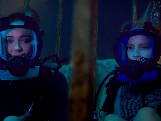 """Lisa, played by Mandy Moore, and Kate, played by Claire Holt, are stuck at the bottom of the ocean floor after their shark-diving excursion goes terribly wrong in """"47 Meters Down."""""""